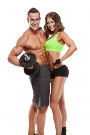 Fitness young sporty couple with dumbbell