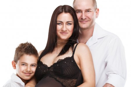 Beautiful young family with little son