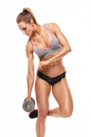 Nice sexy woman doing workout with dumbbell