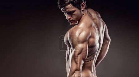 Man Fitness Model posing back muscles and tricep