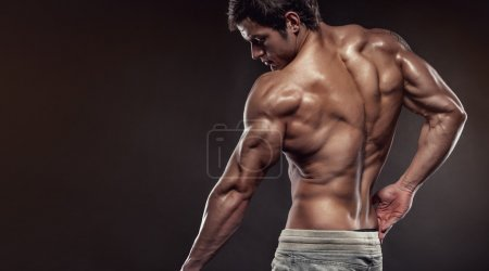 Strong Athletic Man Fitness Model posing