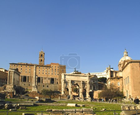 The ancient Forum with its temples and monuments is in the middle of the city of Rome Italy