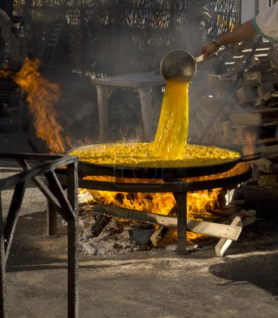 The Stages of Cooking a Paella in a gigantic Pan in Nerja Spain