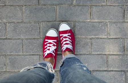 Photo for Women in red sneakers walking in park - Royalty Free Image