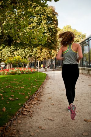 Running girl in Luxembourg Gardens in Paris, France