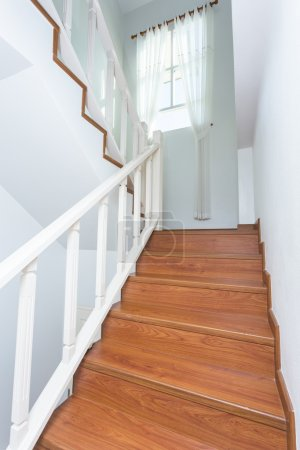 Photo for Wooden staircase made from laminate wood in white modern house - Royalty Free Image
