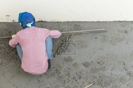 plasterer concrete cement worker plastering flooring of house co