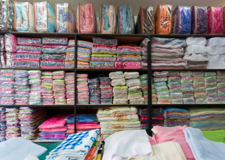 warehouse of towel softness fluffy fiber fabric on shelf
