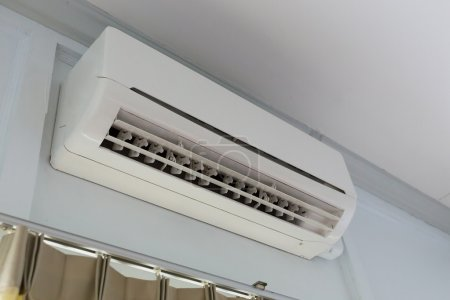 air conditioner system on white wall room