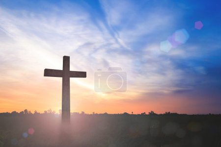 Photo for Silhouette wooden cross on autumn sunset background - Royalty Free Image