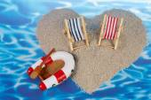 Heart shaped island with toy objects