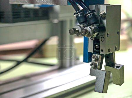Photo pour Pneumatique d'entrée à poignée du robot, la poignée est un matériel d'alliage d'aluminium. - image libre de droit