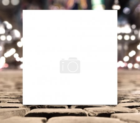 Blank white square paper template banner on the road pavement bricks with unfocused background