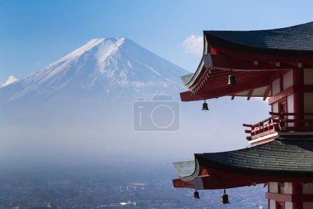 Mt. Fuji viewed from behind red Chureito Pagoda
