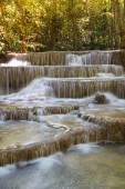 Deep forest stream waterfall in national park of Thailand