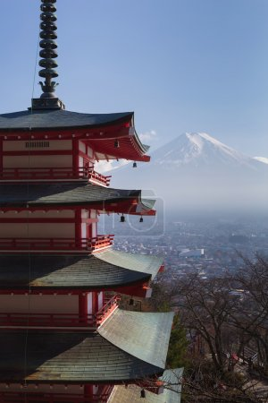 Fuji volcano mountain behind red pagoda