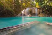 Blue stream waterfall in deep rain forest of Thailand