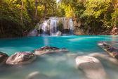 Blue stream waterfall locate in Erawan Nation Park