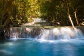 Spring blue stream water falls in national park of Thailand