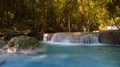 Deep blue stream waterfalls in National park of Thailand