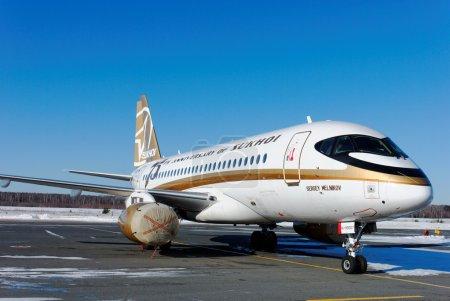 "The passenger SSJ-100 plane in an original livery of ""75 years of Sukhoi Design Bureau"" at the airport of Nizhny Novgorod"