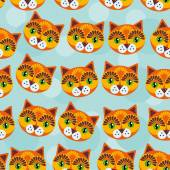 Cat Seamless pattern with funny cute animal face on a blue background Vector