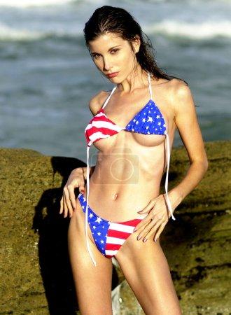 Photo pour Patriotic Flag Bikini - Untied Top - String Bikini - Busty Brunette - image libre de droit