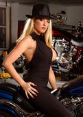 Sexy blond woman   posing with motorcycle