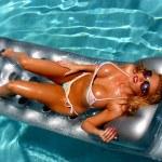 Постер, плакат: Miss Nude Universe Sunbathing on a Float Landscape