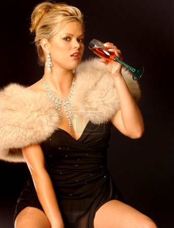 Sliver Necklace and Earrings - Black Dinner Dress - Tan Fur Stole - Elegant Blonde Drinking a Glass of Wine