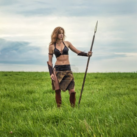 Girl warrior in the field. Amazon on patrol.