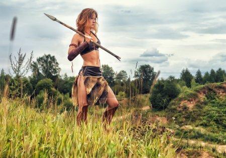 Girl warrior in the field. Amazon on patrol