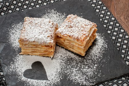 Two piece of Mille-Feuille puff pastry or Napoleon