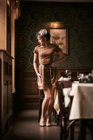 Portrait of young female interior of the restauran...