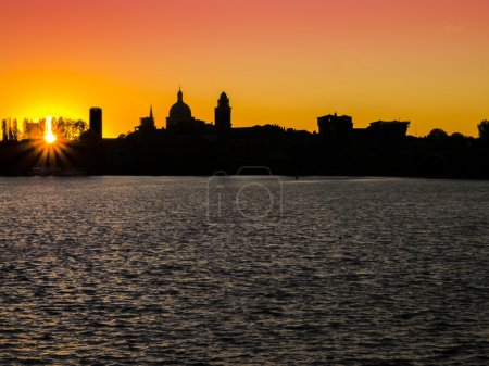 Scenic view of Mantua silhouette at sunset, Italy...