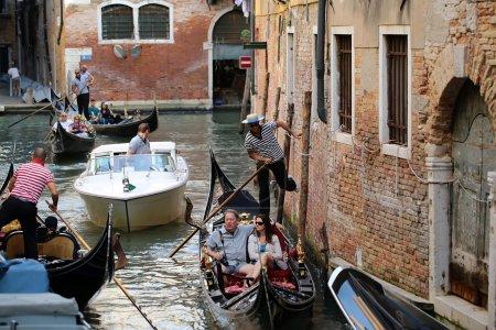 Gondolas rowing between narrow street