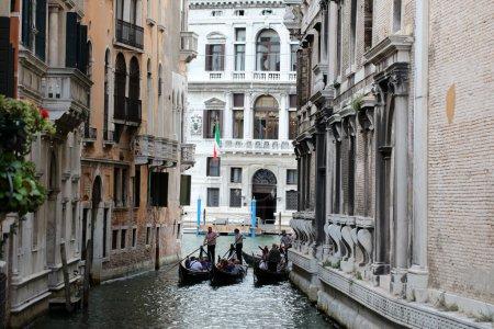three gondolas on narrow street