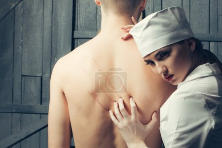 Nurse with young man