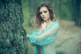Sensual woman in forest