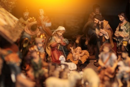 Christmas scene with figurines including Jesus, Mary, Joseph, king