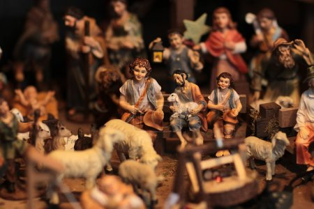 Christmas scene with figurines including sheep and shepherds