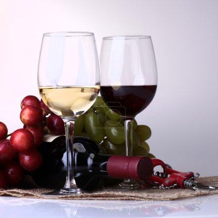 Wineglasses, bottle and grape