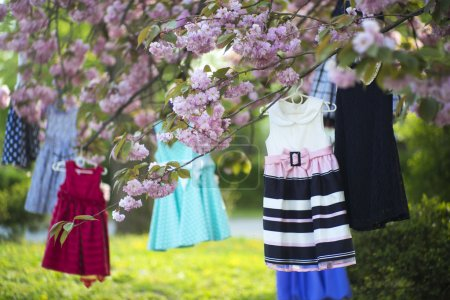 Baby dresses on the tree