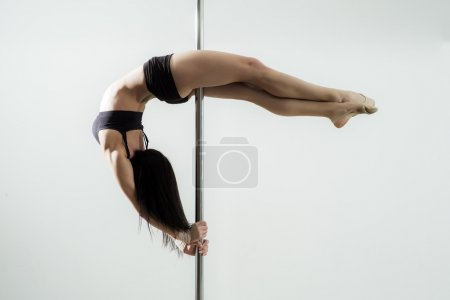 Photo for Flexible sexy girl dancing in black lingerie on the pole on white background copyspace, horizontal picture - Royalty Free Image