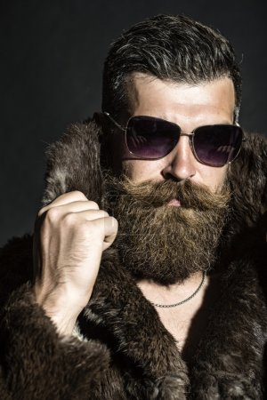 Brutal man in fur coat