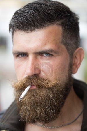 Smoking unshaven man
