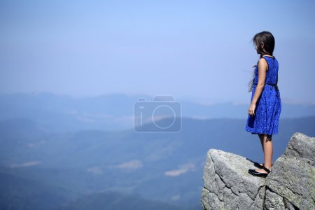 Thoughtful girl in mountains