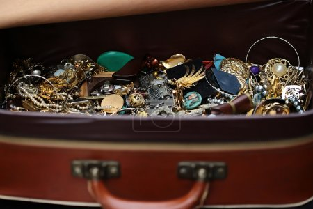 Different fashion bijouterie in suitcase