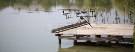 Two carp carbon fishing rods spinning reels with s...