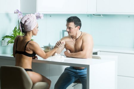 Arm wrestling of sexy couple